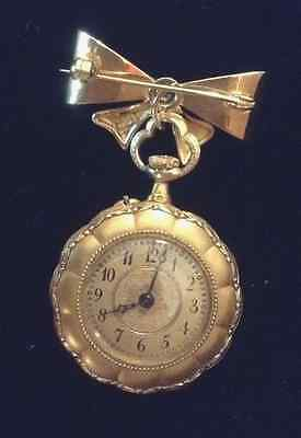 VACHERON CONSTANTIN 18K WATCH WITH DIAMONDS AND HIGH RELIEF CASE AND 14K BROOCH