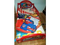 Cars 2 toddler bed with mattress and bedding.Excellent condition.