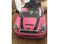 Pink mini electric ride on car