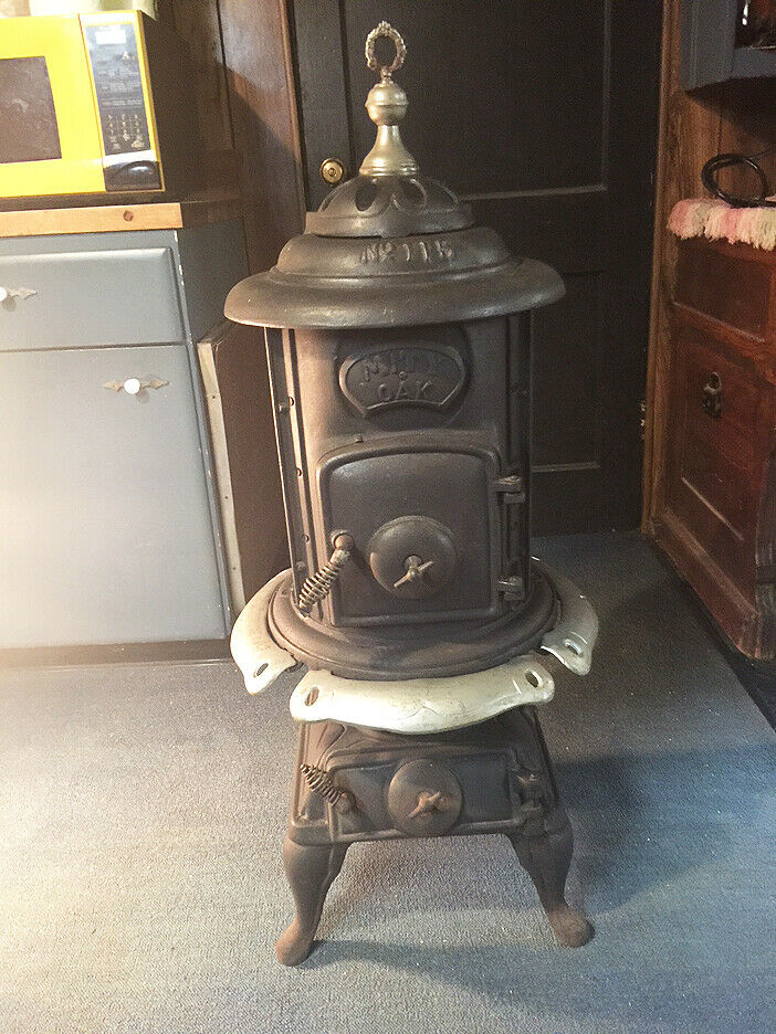 Photo Antique Mity Oak Parlor Stove North Manchester FDY Company