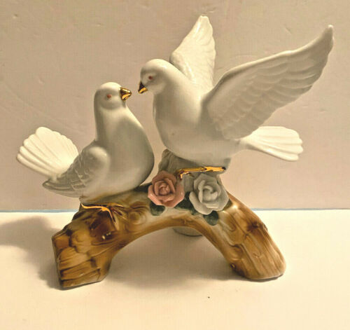 Porcelain Figurine of Two Doves on a Limb with flowers by their feet.