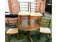 DELIVERY AVAILABLE High quality solid oak extending dining table and four chairs