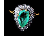 Emerald and diamond 18ct gold ring. Natural Emerald surrounded by 18 sparkling diamonds