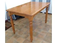 John Lewis solid wood dining table with turned legs.