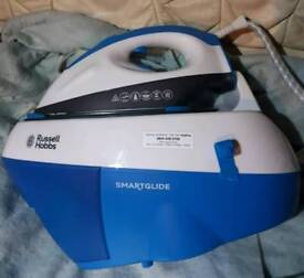 Russell Hobbs Smartglide Steam Generator Iron. In used conditions.