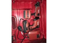 Hilti collated screw gun with charger and 2 battery's