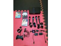 PS2 in good condition with Singstar games, microphones and controllers
