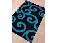 Brand new black and teal rug