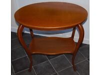 Antiques: A beautifully elegant, bow legged two tier occasional table.