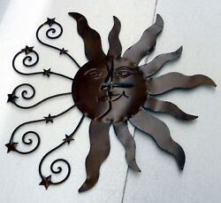 ORNATE 23 SUN CLOCK WITH TWO SETS OF RAYS