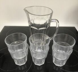 Cut glass pitcher with six glass tumblers