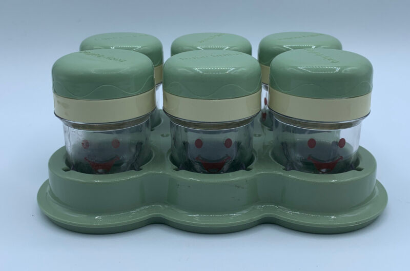 Six baby bullet jars and tray