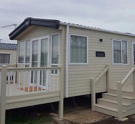 Brand new caravan for rent. Alberta holiday park . 3 berth sleeps 8 , patio doors decking area