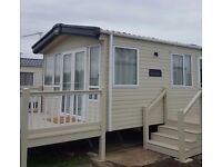 Brand new caravan for rent. Alberta holiday park . 3 berth sleeps 8 , patio doors decking area