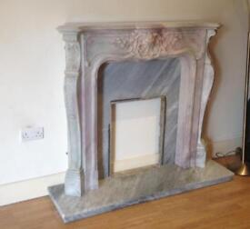 Solid grey/white marble fire surround