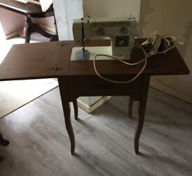 Antique unit with built in sewing machine