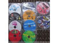 10 Wii Games + 2 Mario Kart Steering Wheels