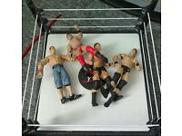 Wwe wrestling ring with 4 figures