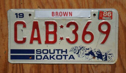 1986 South Dakota MT Rushmore License Plate # CAB 369