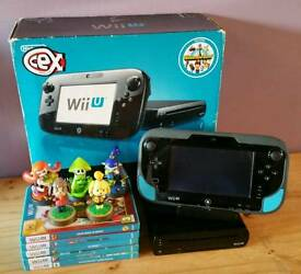 Nintendo Wii U console with 5 games and amiibo