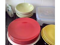 Complete set of colourful plates, glasses and mugs