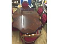 Beautiful antique Italian inlay dining table with red velour chairs
