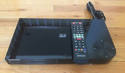 Samsung BD-F5900 3D Blu-ray Player with remote control.