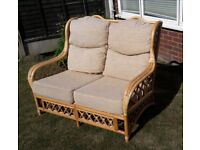 Small, two seater sofa suitable for conservatory use, in good condition from a smoke free home