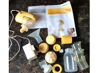 Medela 'Electric Mini' breast pump with accessories