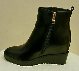 Wedge ankle boots with zip