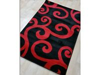 Brand new black and red rug 2