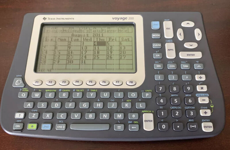 TEXAS INSTRUMENTS Voyage 200 Graphing Calculator **Works** Read for Details