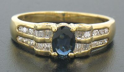 18k Yellow Gold .94ctw Solitaire Oval Sapphire w/ Baguette & Bout Diamond Ring