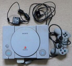 SONY PLAY STATION 1 + 8 GAMES