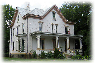 Victorian cube house with porches, traditional floor plan with bay window