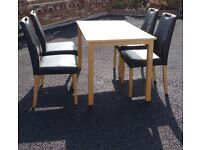 Small table and 4 faux leather chairs