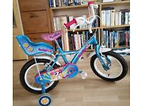 Girl's bike with helmet and accessories in excellent condition.