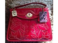New red leather handbag