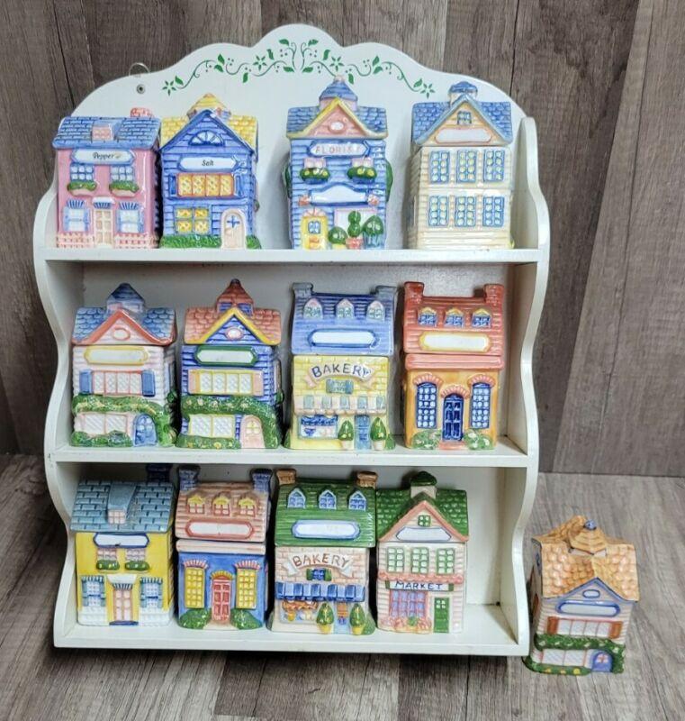 Wonderful Set of 13 Vintage Avon Spice Jars Houses Cottages With Storage Rack