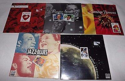 Group Of 5  Sealed Us Postal Stamps Folios  Moon Landing Love Jazz  Blues Etc
