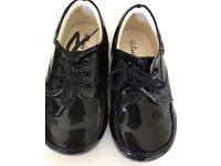 Children's black laced patent leather shoes