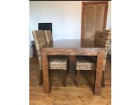 Dakota mango extendable dining table and four chairs.