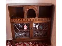 Dark Wooden Sideboard with archway