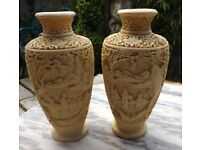 Pair of carved type Ivory coloured Oriental Chinese Japanese vases very detailed