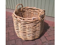 Large round thick wicker basket with handles, in excellent condition