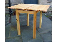 Small extendable pine table