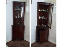 CORNER DISPLAY UNIT - Dark wood appearance with storage below and glazed display section above