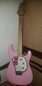 Pink Fender Squier Hello Kitty Stratocaster guitar