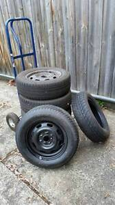 5x ford laser wheels and tyres 185/65/14 Nunawading Whitehorse Area Preview