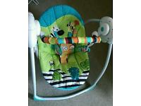 Electronic baby swing with multiple positions, harness and toy bar.
